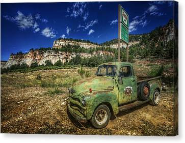 A Chevy And Checkerboard Mesa Canvas Print by Christine Annas