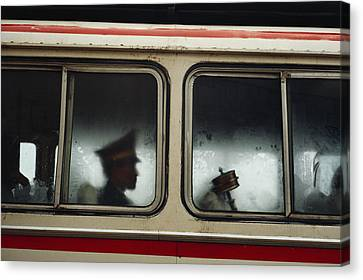 A Chinese Pla Soldier Sits On A Bus Canvas Print by Justin Guariglia
