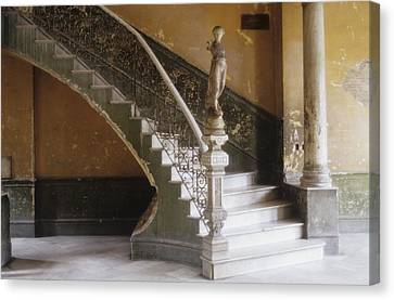 A Circular Marble Staircase And Statue Canvas Print by Kenneth Ginn