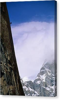A Climber Rappels Down The Sheer Canvas Print by Bill Hatcher