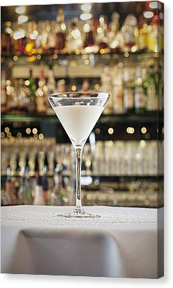 A Cocktail On A Table Canvas Print by Larry Washburn