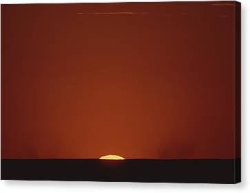 A Contrast Shot Of Red Sky And Dark Canvas Print by Kenneth Garrett
