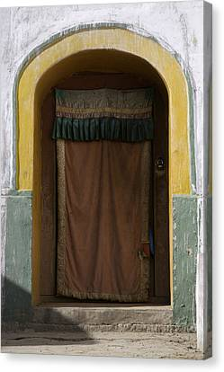 A Curtained Entrance To A Monastery Canvas Print by David Evans