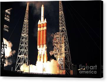 A Delta Iv Heavy Rocket Lifts Off Canvas Print by Stocktrek Images