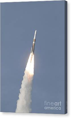 A Delta Iv Rocket Roars Into The Sky Canvas Print by Stocktrek Images