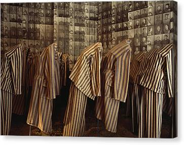 A Display Of Photographs And Uniforms Canvas Print by James L. Stanfield