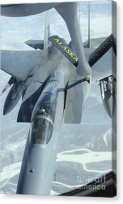 A F-15 Eagle Receives Fuel Canvas Print by Stocktrek Images