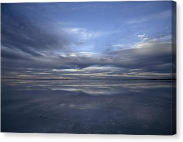 A Fading Sunset Reflects Off The Still Canvas Print by Jason Edwards