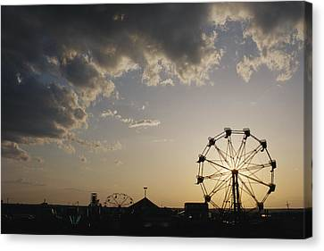 A Ferris Wheel Is Silhouetted Canvas Print by Stephen Alvarez