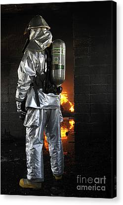 A Firefighter Waits For A Fire To Get Canvas Print by Stocktrek Images