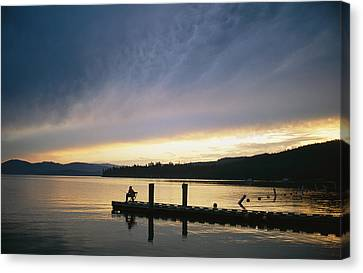 A Fisherman At Dawn Tries His Luck Canvas Print by Michael S. Lewis