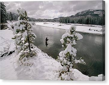 A Fisherman Tries His Luck Canvas Print by Annie Griffiths