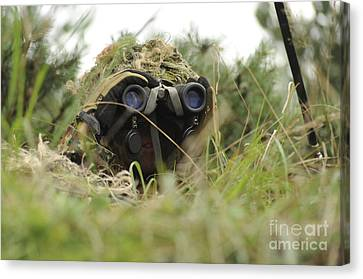 A German Bundeswehr Soldier Camouflages Canvas Print by Stocktrek Images