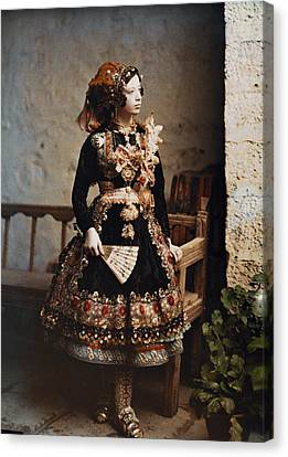 A Girl Poses In Her Traditional Costume Canvas Print by Gervais Courtellemont