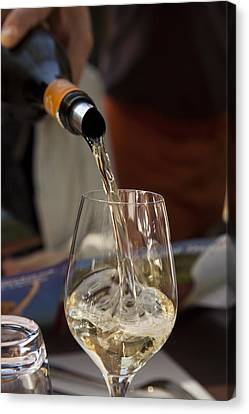 A Glass Of White Wine Being Poured Canvas Print by Taylor S. Kennedy