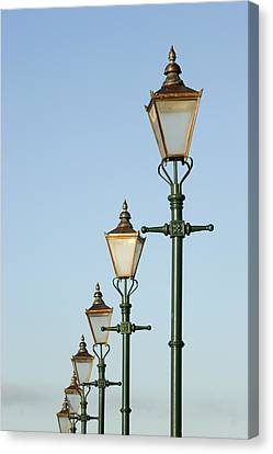 A Group Of Old Gas Street Lamps Canvas Print by Bill Hatcher