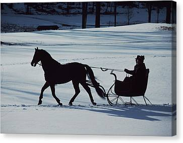 A Horse-drawn Sleigh Ride At Twilight Canvas Print by Ira Block