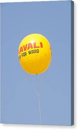 A Hot Air Balloon In The Blue Sky Canvas Print by Ashish Agarwal