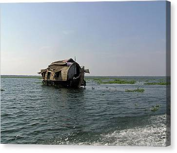 A Houseboat Moving Placidly Through A Coastal Lagoon In Alleppey Canvas Print by Ashish Agarwal
