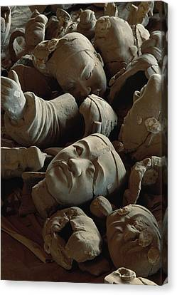 A Jumbled Heap Of Terra-cotta Heads Canvas Print
