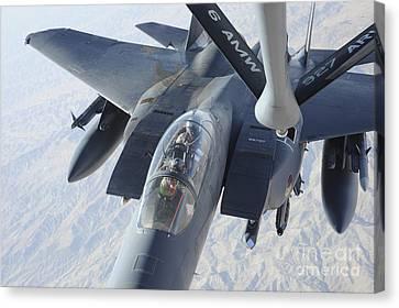 A Kc-135 Stratotanker Refuels An F-15e Canvas Print by Stocktrek Images