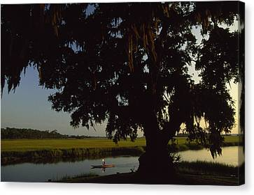 A Late Afternoon Kayaker In The Marshes Canvas Print by Michael Melford
