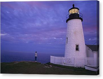 A Lighthouse Visitor Enjoys A Twilight Canvas Print by Stephen St. John