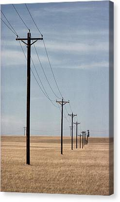 A Line Of Telephone Poles Travels Canvas Print by George Grall