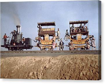 A Locomotive And Two Coaches Canvas Print by Charles Martin