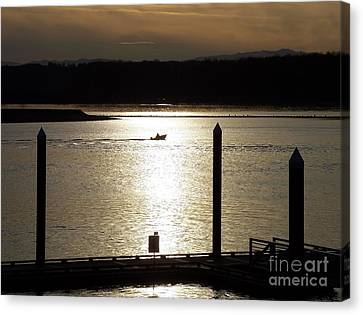 A Lone Boat At Sunset Canvas Print by Chalet Roome-Rigdon