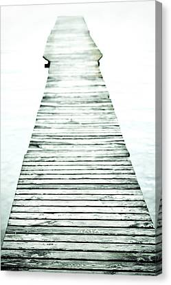 A Long And Old Wooden Bridge Into The Bright Light Canvas Print by Joana Kruse