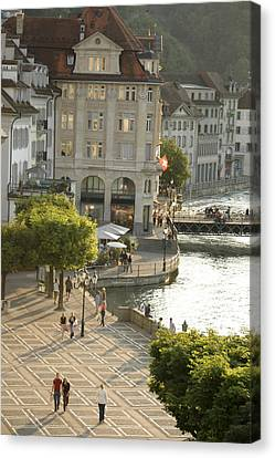 A Lucerne Street Scene In The City Canvas Print by Annie Griffiths
