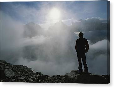 A Man In Silhouette Looking Canvas Print