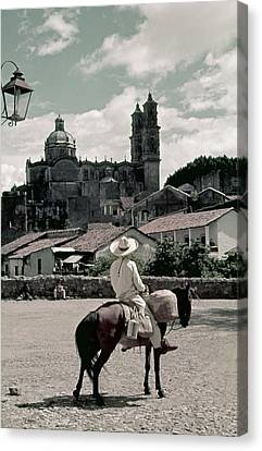 A Man On Horseback Looks At The Borda Canvas Print by Luis Marden