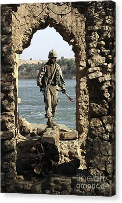 A Marine Searching A Stone Aqueduct Canvas Print by Stocktrek Images