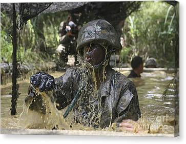 A Marine Splashes As He Makes His Way Canvas Print by Stocktrek Images