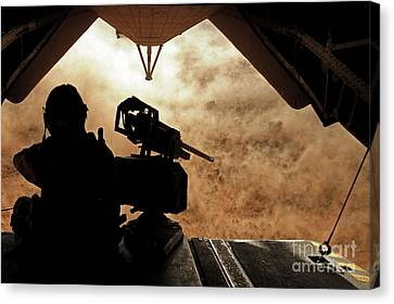 A Marine Waits For Dust To Clear While Canvas Print by Stocktrek Images