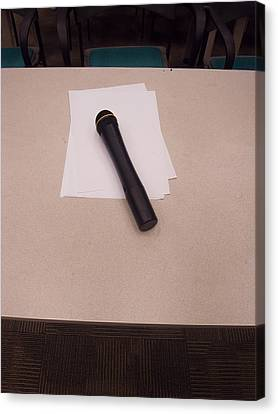 A Microphone On The Lectern Of A Presentation Room Canvas Print by Ashish Agarwal