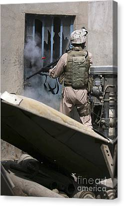 A Military Policeman Uses A Breaching Canvas Print by Stocktrek Images