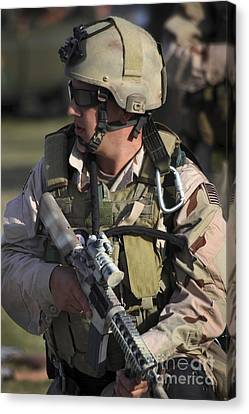 Fort Pierce Canvas Print - A Military Reserve Navy Seal Kneels by Michael Wood