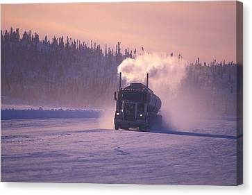 A Mine Transport Truck Drives Canvas Print by Nick Norman