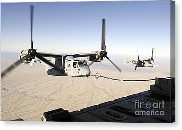 A Mv-22 Osprey Refuels Midflight While Canvas Print by Stocktrek Images