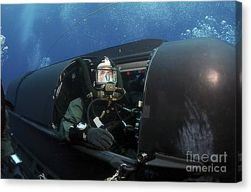 A Navy Seal Prepares To Launch A Seal Canvas Print by Stocktrek Images