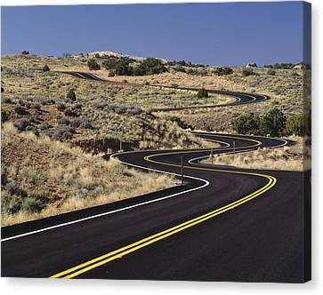 A Newly Paved Winding Road Up A Slight Canvas Print by Greg Probst