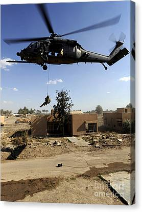 A Pararescueman Rappels From An Hh-60 Canvas Print by Stocktrek Images