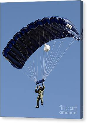 A Paratrooper Descends Through The Sky Canvas Print by Stocktrek Images