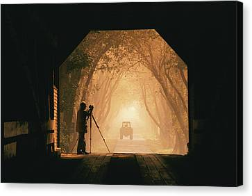 A Photographer Sets Up His Camera Canvas Print by Richard Nowitz