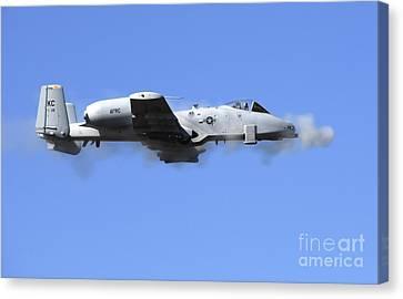 A Pilot In An A-10 Thunderbolt II Fires Canvas Print by Stocktrek Images