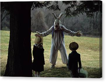 A Rabbit Meets Two Children During An Canvas Print by Joel Sartore