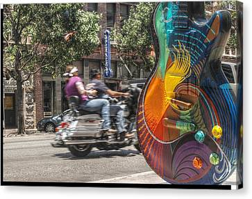 A Rainbow Guitar On Congress In Austin Canvas Print by Jennifer Holcombe